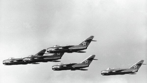 Russian MIG 15 jet fighters during a demonstration at the East German Air Force Sports and Cultural Festival, at Cottbus, East Germany, on Sept. 3, 1957 - Sputnik International