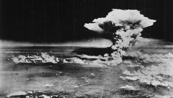 An atomic cloud billows above Hiroshima city following the explosion of the first atomic bomb to be used in warfare in Hiroshima, in this handout photo taken by the U.S. Army on August 6, 1945, and distributed by the Hiroshima Peace Memorial Museum. The words written on the photo are from the source - Sputnik International