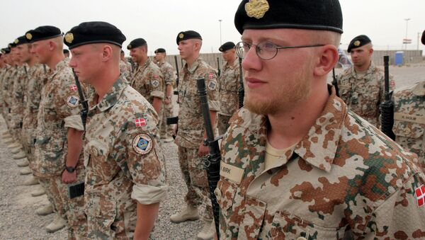 Danish soldiers stand guard during a ceremony to mark transfer of control of a British military base, in Basra, Iraq, Tuesday, April 24, 2007 - Sputnik International