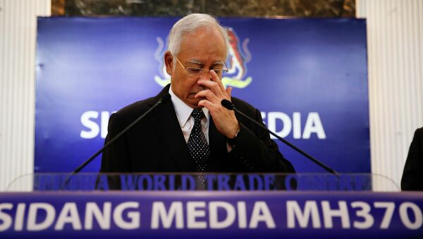 Malaysian Prime Minister Najib Razak, center, gestures before speaking at a special press conference announcing the findings for the ill fated flight MH370 in Kuala Lumpur, Malaysia, early Thursday, Aug. 6, 2015 - Sputnik International