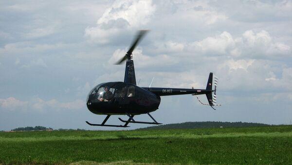 Helicopter Robinson R44 - Sputnik International