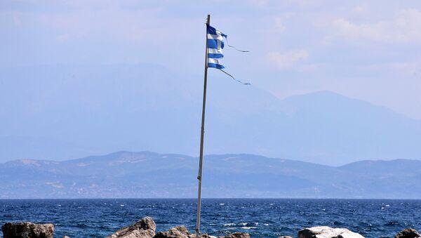 A torn Greek flag flutters at a coast near Antirio, southwest of Athens on August 9, 2015 - Sputnik International