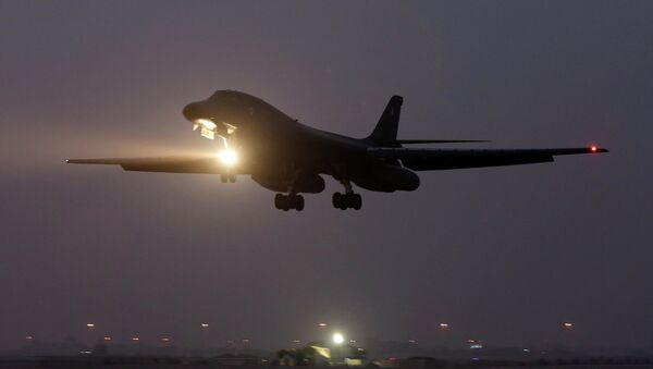 In this photo taken Monday, March 9, 2015, a B-1 bomber prepares to land after finishing a mission at the al-Udeid Air Base in Doha, Qatar - Sputnik International