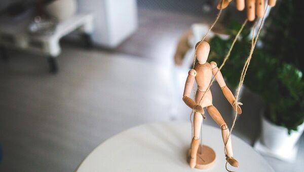 Puppet manipulation - Sputnik International