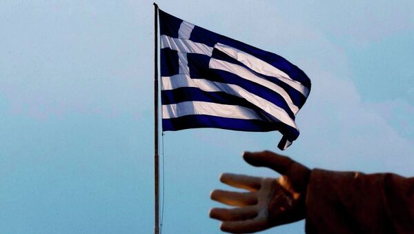 A hand of a statue is seen as the Greek flag waves in Athens, Sunday, June 28, 2015. - Sputnik International
