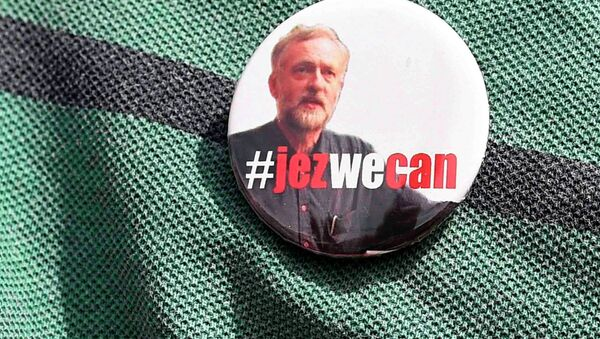 A supporter wears a campaign badge as British Labour Party politician Jeremy Corbyn arrives for a community meeting in north London August 9, 2015. - Sputnik International