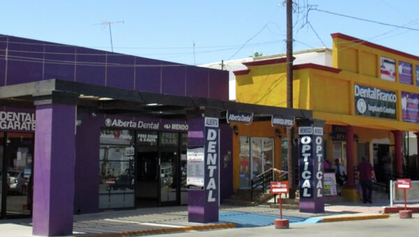 In this Thursday, April 30, 2015 photo, a street full of a dental offices is seen in Los Algodones, Mexico, which sits on the border with California - Sputnik International