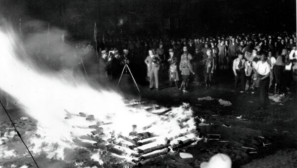 Flames roar high as a crowd gathers to witness thousands of books, considered to be un-German, burn in Opera Square in Berlin, Germany, during the Buecherverbrennung, book burnings on May 10, 1933. - Sputnik International