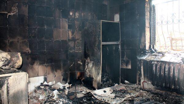 A building destroyed by shelling of the Oktyabrsky village in the Kuibyshevsky district of Donetsk - Sputnik International