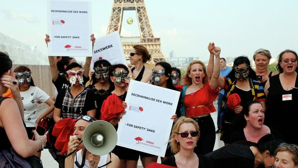 Sex workers take part in a demonstration called by the Strass union and the Roses d'Acier association on June 5, 2015 on the Trocadero square in Paris - Sputnik International