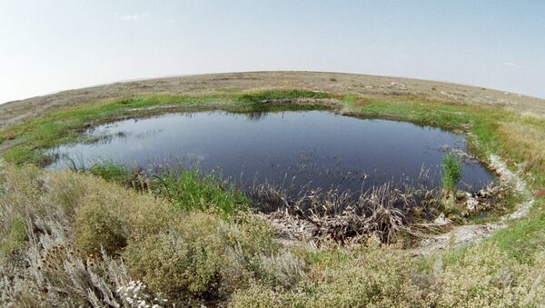 A lake in the place of a surface nuclear explosion on the Semipalatinsk proving ground - Sputnik International