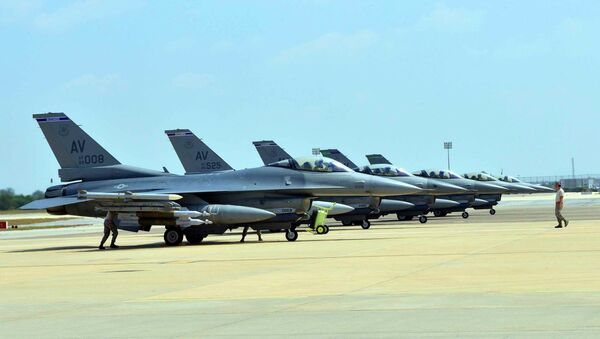 Six US Air Force F-16 Fighting Falcons from Aviano Air Base, Italy, are seen at Incirlik Air Base, Turkey, after being deployed, in this US Air Force handout picture taken August 9, 2015 - Sputnik International