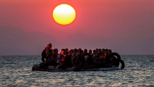 Migrants on a dinghy arrives at the southeastern island of Kos, Greece, after crossing from Turkey, Thursday, Aug. 13, 2015 - Sputnik International