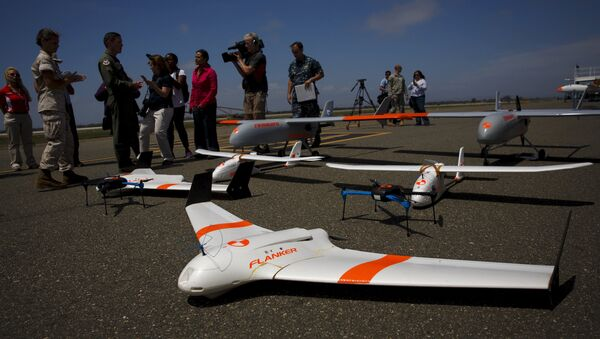 FireFlight UAS unmanned aerial vehicles TwinHawk, Scout, Flanker, and Hawkeye 400, are displayed on the tarmac during Black Dart, a live-fly, live fire demonstration of 55 unmanned aerial vehicles, or drones, at Naval Base Ventura County Sea Range, Point Mugu, near Oxnard, California July 31, 2015 - Sputnik International
