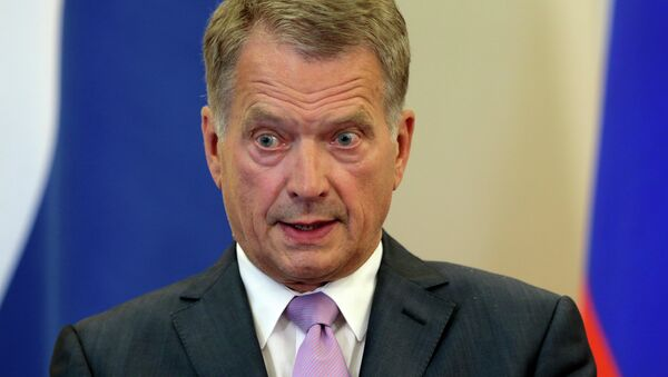Finnish President Sauli Niinisto speaks during his and Russian President Vladimir Putin's news conference after the talks at a residence at the Black Sea resort of Sochi, southern Russia, in Sochi, Russia, Friday, Aug. 15, 2014 - Sputnik International