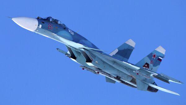Carrier-based Sukhoi Su-33 jet fighter of the 279th Shipborne Fighter Aviation Regiment of the Northern Fleet on a training mission over Severomorsk-3 aerodrome - Sputnik International