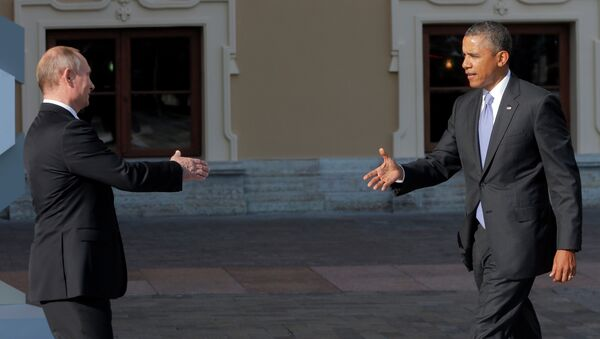 Russia's President Vladimir Putin, left, reaches out to shake hands with U.S. President Barack Obama during arrivals for the G-20 summit at the Konstantin Palace in St. Petersburg, Russia on Thursday, Sept. 5, 2013 - Sputnik International
