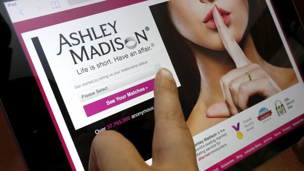 The homepage of the Ashley Madison website is displayed on an iPad, in this photo illustration taken in Ottawa, Canada July 21, 2015 - Sputnik International