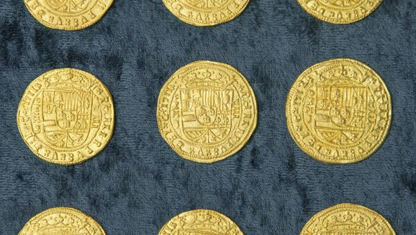Over 350 gold coins from a sunken Spanish Treasure are seen in an undated handout picture courtesy of 1715 Fleet - Queens Jewels - Sputnik International