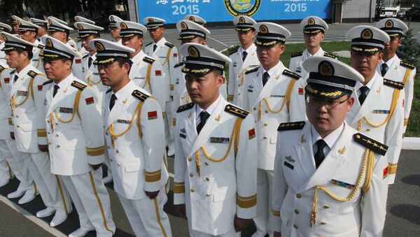 Chinese Navy officers during a ceremony of welcoming the crews of Chinese warships involved in the Naval Cooperation 2015 exercise - Sputnik International