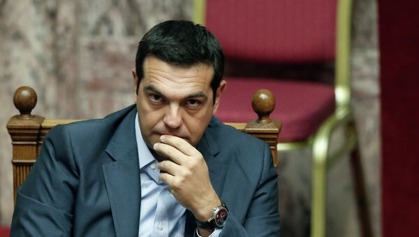 Greek Prime Minister Alexis Tsipras listens during a parliamentary session in Athens, Friday, Aug. 14, 2015 - Sputnik International