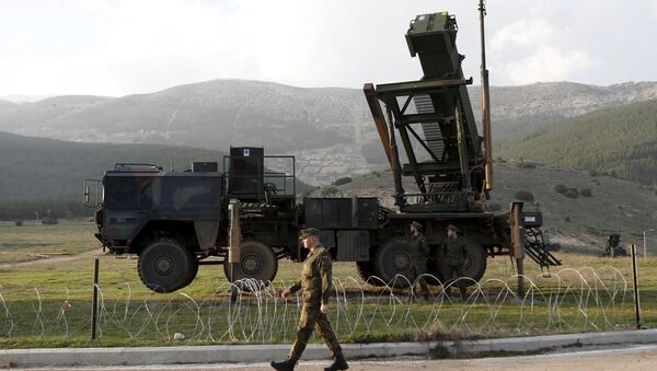 Soldiers of the German armed forces Bundeswehr stand next to the Patriot system before the arrival of Germany's Chancellor Angela Merkel at a Turkish military base in Kahramanmaras in this February 24, 2013 - Sputnik International