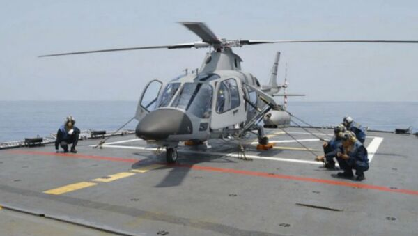 A Philippine Navy weaponised AW109 helicopter on board the frigate BRP Ramon Alcaraz. - Sputnik International