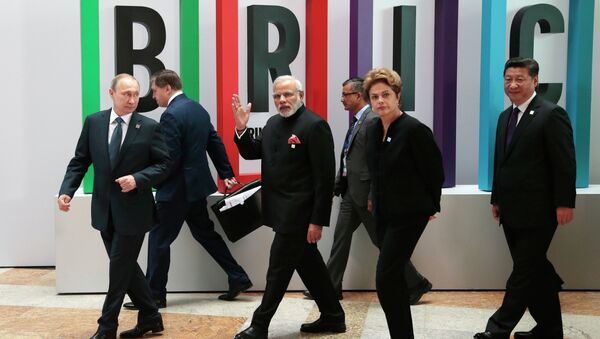 From left in front row: Russian President Vladimir Putin, Indian Prime Minister Narendra Modi, Brazilian President Dilma Rousseff, Chinese President Xi Jinping walk for a plenary session during the summit in Ufa, Russia, Thursday, July 9, 2015 - Sputnik International