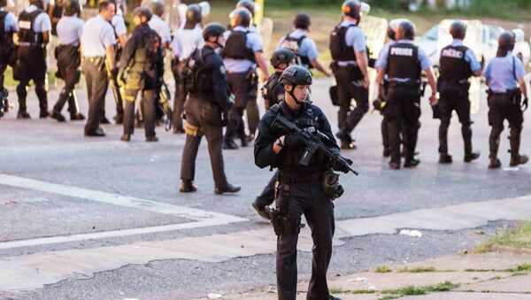 Police line up to block the street as protesters gathered after a shooting incident in St. Louis, Missouri August 19, 2015 - Sputnik International