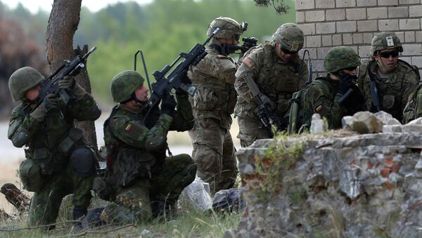 Members of the US Army 173rd Airborne Brigade and Lithuania's soldiers practice during the combined Lithuanian-US training exercise at the Gaiziunai Training Area some 110 kms (69 miles) west of the capital Vilnius Lithuania, Tuesday, July 7, 2015 - Sputnik International