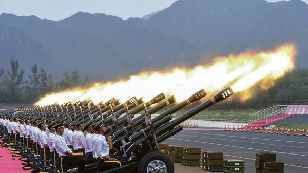 Paramilitary policemen and members of a gun salute team fire cannons during a training session for a military parade to mark the 70th anniversary of the end of the World War Two, at a military base in Beijing, China - Sputnik International