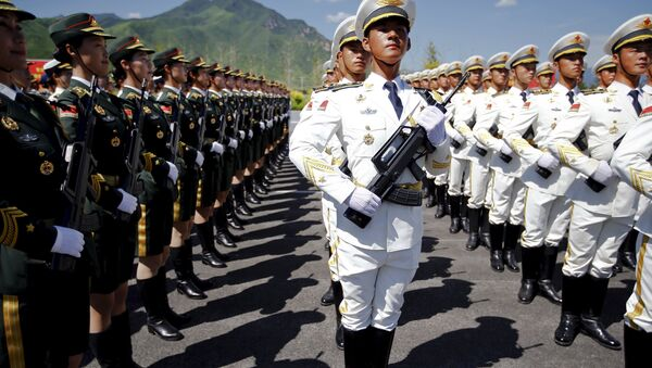 Soldiers of China's People's Liberation Army attend a training session for a military parade to mark the 70th anniversary of the end of World War Two, at a military base in Beijing, China, August 22, 2015 - Sputnik International