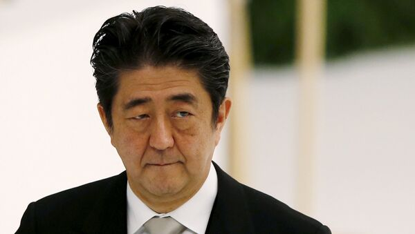 Japan's Prime Minister Shinzo Abe attends a memorial service ceremony marking the 70th anniversary of Japan's surrender in World War Two at Budokan Hall in Tokyo - Sputnik International