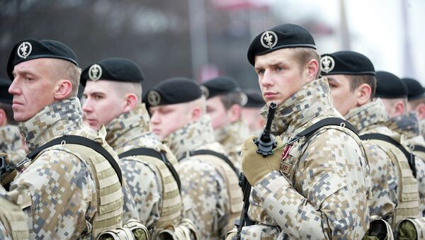 Latvian soldiers stand during a military parade - Sputnik International