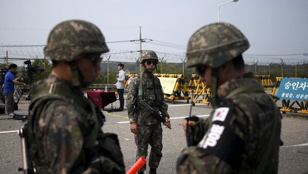 South Korean soldiers stand guard at a checkpoint on the Grand Unification Bridge which leads to the truce village Panmunjom, just south of the demilitarized zone separating the two Koreas, in Paju, South Korea - Sputnik International