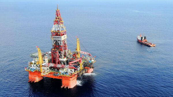 Haiyang Shiyou oil rig 981, the first deep-water drilling rig developed in China, is pictured at 320 kilometers (200 miles) southeast of Hong Kong in the South China Sea. - Sputnik International