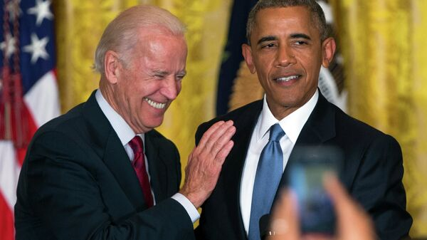 Vice President Joe Biden and President Barack Obama react after a heckler is removed from the East Room of the White House. - Sputnik International