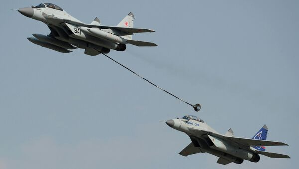 Russian multi-purpose jet fighters MiG-29, left, and MiG-35 perform a demonstration flight at the MAKS-2011 international air show in Zhukovsky near Moscow - Sputnik International