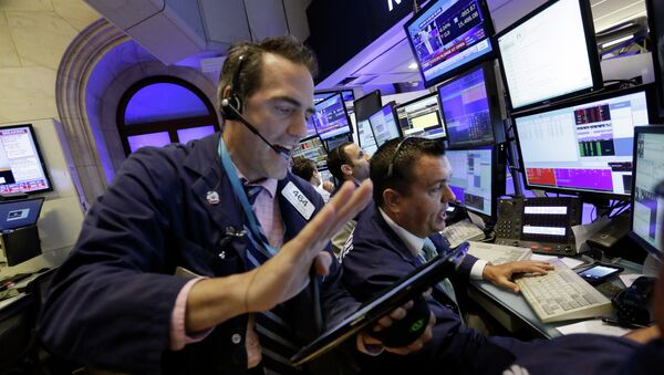 Traders Gregory Rowe, left, and Robert Finnerty work in a booth on the floor of the New York Stock Exchange, Monday, 24 August 2015 - Sputnik International