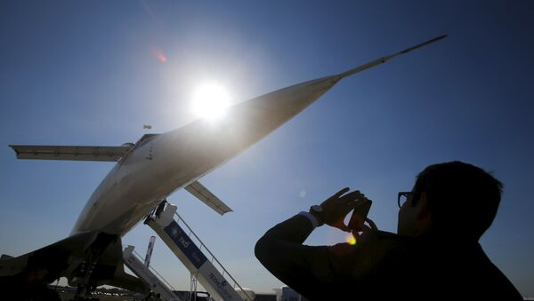 A visitor takes a picture of a Tupolev Tu-144 commercial supersonic transport aircraft on display at the MAKS International Aviation and Space Salon in Zhukovsky, outside Moscow, Russia, August 25, 2015 - Sputnik International