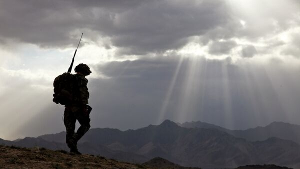 US Army Spc. Newton Carlicci travels dismounted while on his way back to his outpost from the village of Paspajak, Charkh District, Logar province, Afghanistan. File photo - Sputnik International