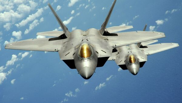 Two US Air Force F-22 Raptor stealth jet fighters fly near Andersen Air Force Base, Guam. File photo - Sputnik International