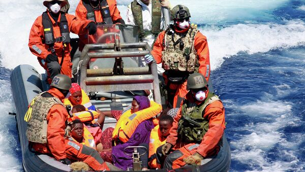 In this Aug. 23, 2015 picture provided by the German Navy pregnant Somali refugee, Rahma Abukar Ali center, sits in a boat of the German Navy in the Mediterranean Sea, near Italy - Sputnik International