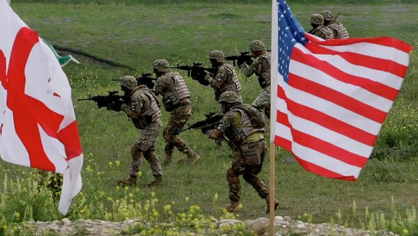 US and Georgian servicemen, with Georgian and US flags in front, take part in the joint US-Georgia military exercise at the Vaziani base outside the Georgian capital, Tbilisi, Georgia, Thursday, May 21, 2015 - Sputnik International
