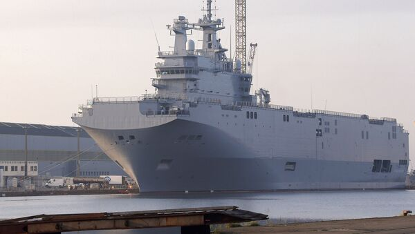 The Vladivostok warship, the first of two Mistral-class helicopter carriers ordered by Russia, docks on the port of Saint-Nazaire, western France - Sputnik International