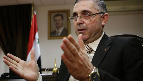 Syrian Minister of State for National Reconciliation Affairs Ali Haidar gives an interview with AFP in Damascus on November 10, 2014. - Sputnik International
