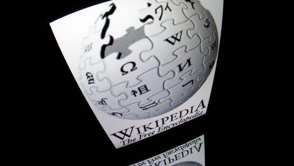 The Wikipedia logo is seen on a tablet screen on December 4, 2012 in Paris - Sputnik International