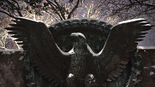 Snow falls on an eagle emblem at the Franklin D. Roosevelt memorial in Washington DC on February 16, 2015 - Sputnik International
