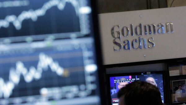 A screen at a trading post on the floor of the New York Stock Exchange is juxtaposed with the Goldman Sachs booth - Sputnik International
