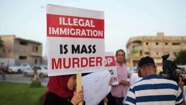 In this Thursday, Aug. 27, 2015 photo, local residents hold a demonstration against illegal immigration after hearing news that a boat carrying hundreds of migrants capsized off the coast, in Zuwara, Libya - Sputnik International